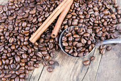 Coffee beans and cinnamon next scoop. Stock Images