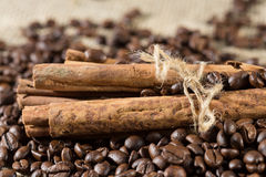 Coffee beans with cinnamon Stock Images