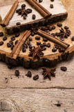 Coffee beans and cinnamon on rustic surface Royalty Free Stock Photo