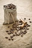 Coffee beans and cinnamon on sacking Royalty Free Stock Image