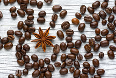Coffee beans, cinnamon and star anise on white background Royalty Free Stock Photography