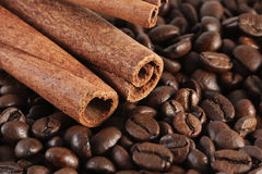 Coffee beans and cinnamon stick Royalty Free Stock Images