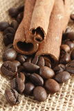 Coffee beans and cinnamon stick Stock Images