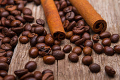 Coffee beans and cinnamon stick. Brown coffee grains and cinnamon. Spice for beverages. Aroma of robusta Stock Images