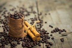 Coffee beans and cinnamon stick Royalty Free Stock Photos