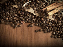 Coffee beans with cinnamon sticks Royalty Free Stock Image