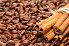 Coffee beans and cinnamon sticks Royalty Free Stock Image