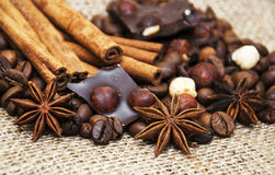 Coffee beans with cinnamon sticks and chocolate Stock Photo