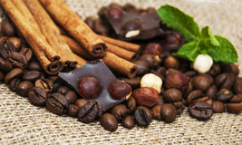 Coffee beans with cinnamon sticks and chocolate Stock Photo