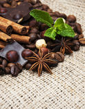 Coffee beans with cinnamon sticks and chocolate Stock Image