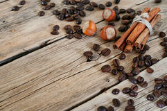 Coffee beans with cinnamon sticks and hazelnuts Stock Photography