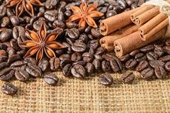 Coffee beans and cinnamon sticks Royalty Free Stock Photo