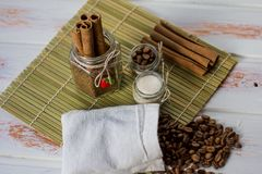 Coffee beans and cinnamon sticks royalty free stock photo