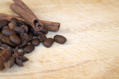 Coffee beans with cinnamon sticks Stock Photography