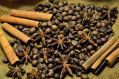 Coffee beans, cinnamon sticks and star anise. Coffee beans, cinnamon sticks, star anise on the background of old sacking, space for text Stock Image