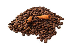 Coffee beans and cinnamon sticks Stock Photography