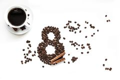 Coffee beans with cinnamon on a white background March 8 cup of coffee stock photography