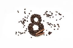 Coffee beans with cinnamon on a white background, March 8 stock image
