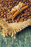 Coffee beans and cinnamon on a wooden background Stock Image