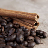 Coffee beans and cinnamon on wooden table. Close up photo Royalty Free Stock Image