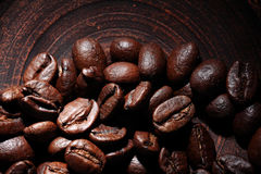 Coffee beans on a clay dish Stock Photography