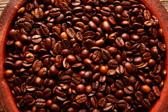 Coffee beans in a clay dish texture Royalty Free Stock Photo