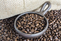 Coffee Beans in a Clay Pot Stock Images