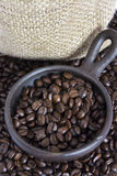 Coffee Beans in a Clay Pot III. Coffee beans in a small clay pot. Image has a background of jute fibers royalty free stock images