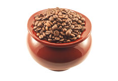 Coffee beans in a clay pot isolated Stock Photography