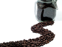 Coffee Beans and a Clear Glass Container Stock Photo