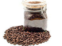 Coffee Beans and a Clear Glass Container Royalty Free Stock Photo