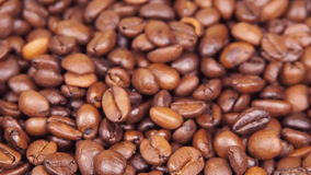 Coffee beans. Close-up. Along coffee beans. Floating over fried coffee stock video