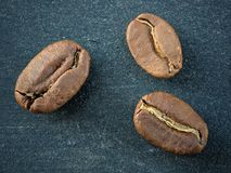 Coffee beans close up on black backdrop board royalty free stock image