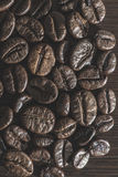 Coffee beans. Close up. Dark light Stock Images