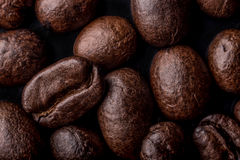 Coffee beans close up. A few coffee beans background, macrophtography Royalty Free Stock Photography
