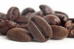 Coffee beans close up in isolated white background Royalty Free Stock Photo