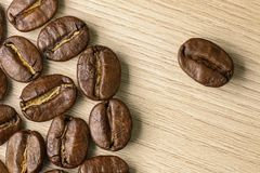 Coffee beans close-up. Macro. Wood background Stock Images