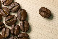 Coffee beans close-up. Macro. Wood background Royalty Free Stock Image