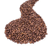 Coffee Beans close up. Shape. Royalty Free Stock Photos
