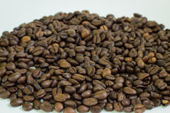 Coffee beans. Close-up on white background Stock Photos