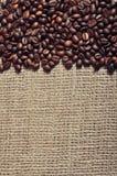 Coffee beans. Closeup on burlap background Stock Photos