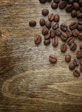 Coffee beans closeup on old wood Stock Photos