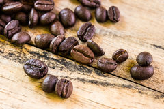 Coffee beans closeup on wooden Stock Photography