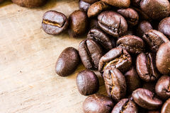 Coffee beans closeup on wooden Royalty Free Stock Images