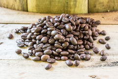 Coffee beans closeup on wooden Royalty Free Stock Photography