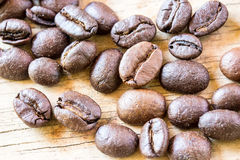 Coffee beans closeup on wooden Stock Photos