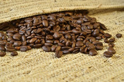 Coffee beans in a cloth Royalty Free Stock Photos
