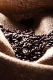 Coffee beans on cloth sack Royalty Free Stock Images