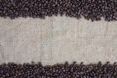 Coffee beans on cloth sack background Stock Images