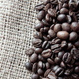 Coffee beans on cloth sack Royalty Free Stock Photos